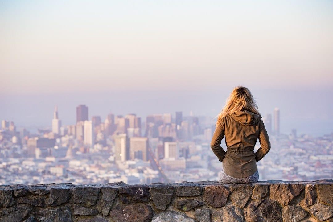 Woman overlooking city skyline