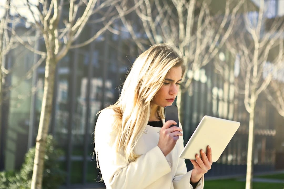 woman reading on an ipad