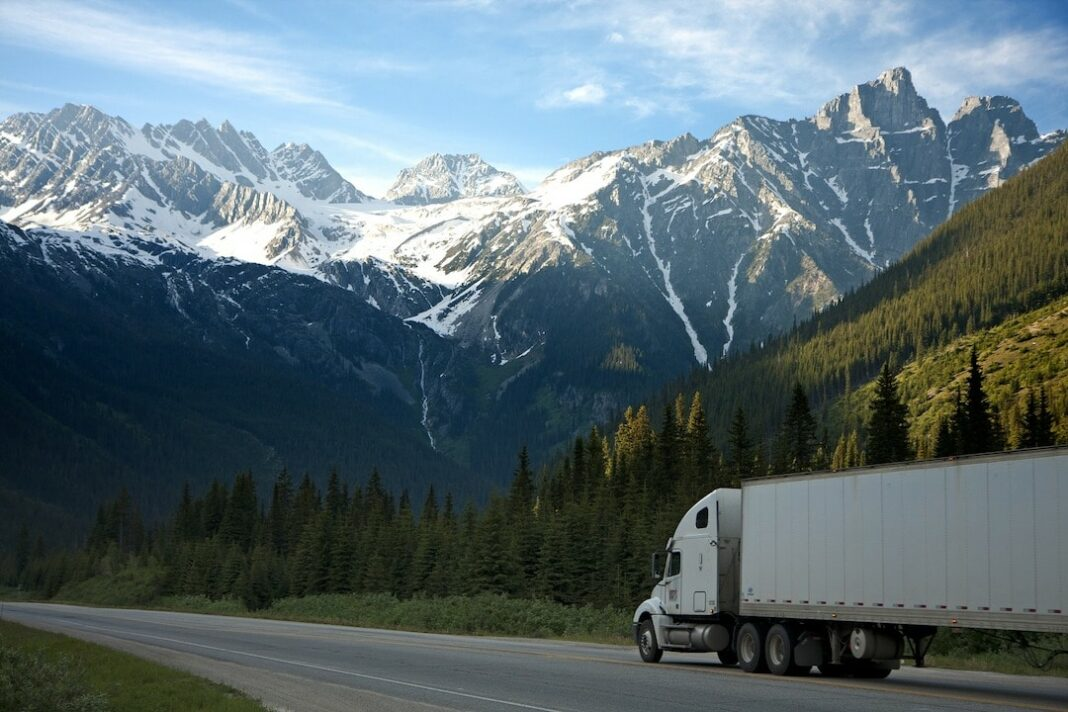 semi truck driving through mountains